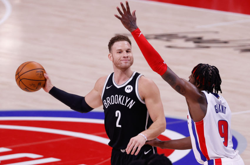 Mar 26, 2021; Detroit, Michigan, USA; Brooklyn Nets forward Blake Griffin (2) is defended by Detroit Pistons forward Jerami Grant (9) in the second half at Little Caesars Arena. Mandatory Credit: Rick Osentoski-USA TODAY Sports