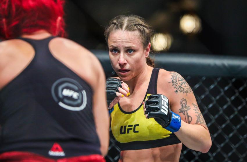 Jul 28, 2018; Calgary, Alberta, Canada; Randa Markos (red gloves) fights Nina Ansaroff (blue gloves) during UFC Fight Night at Scotiabank Saddledome. Mandatory Credit: Sergei Belski-USA TODAY Sports