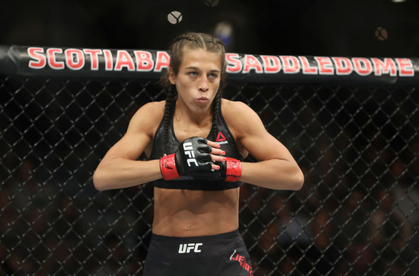 Jul 28, 2018; Calgary, Alberta, Canada; Joanna Jedrzejczyk (red gloves) fights Tecia Torres (blue gloves) during UFC Fight Night at Scotiabank Saddledome. Mandatory Credit: Sergei Belski-USA TODAY Sports