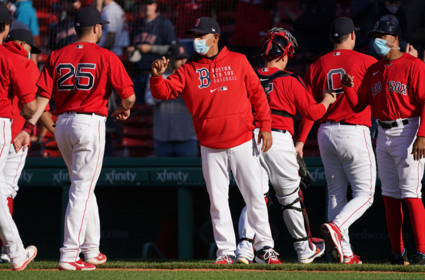 May 6, 2021; Boston, Massachusetts, USA; Boston Red Sox manager Alex Cora (13) (center) congratulates his team after defeating the Detroit Tigers in nine inning at Fenway Park. Mandatory Credit: David Butler II-USA TODAY Sports
