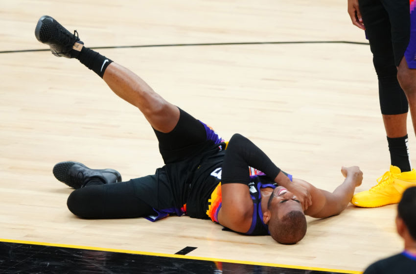 May 23, 2021; Phoenix, Arizona, USA; Phoenix Suns guard Chris Paul reacts after suffering an injury against the Los Angeles Lakers in the first half during game one in the first round of the 2021 NBA Playoffs. at Phoenix Suns Arena. Mandatory Credit: Mark J. Rebilas-USA TODAY Sports