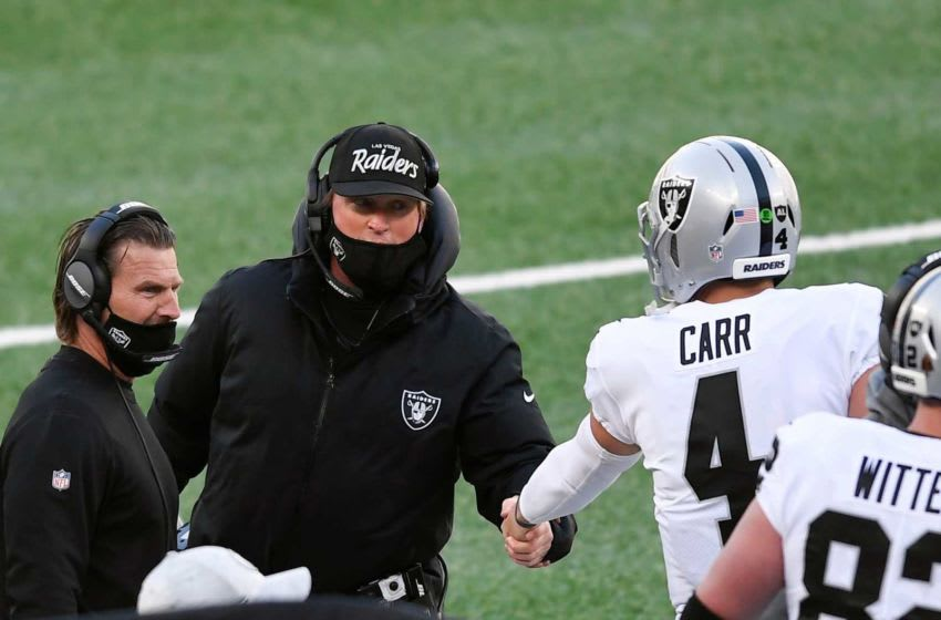 Las Vegas Raiders head coach Jon Gruden shakes quarterback Derek Carr's (4) hand after a touchdown in the first half against the New York Jets at MetLife Stadium on Sunday, Dec. 6, 2020, in East Rutherford. Nyj Vs Lv