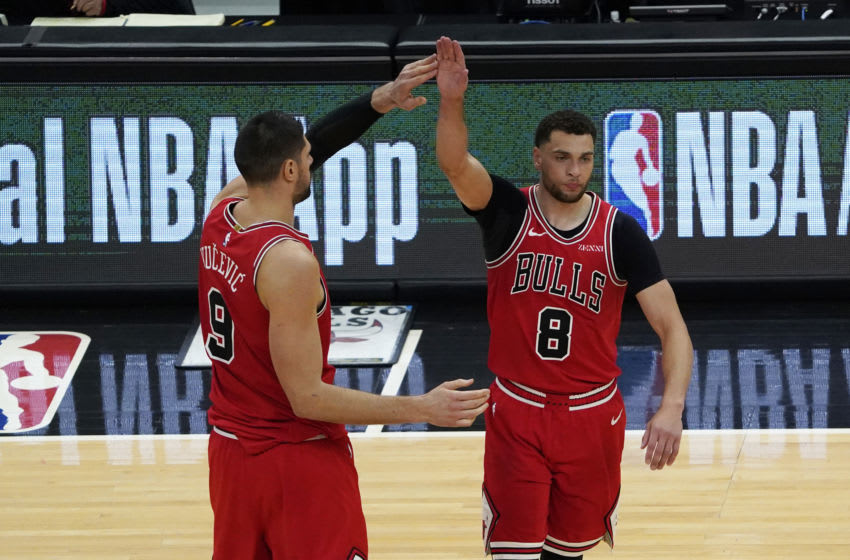 May 7, 2021; Chicago, Illinois, USA; Chicago Bulls guard Zach LaVine (8) celebrates his three point basket against the Boston Celtics with center Nikola Vucevic (9) during the second half at United Center. Mandatory Credit: David Banks-USA TODAY Sports