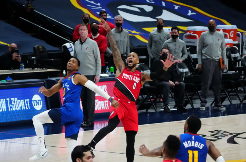 Jun 1, 2021; Denver, Colorado, USA; Portland Trail Blazers guard Damian Lillard (0) shoots and ties the game in overtime against the Denver Nuggets during game five in the first round of the 2021 NBA Playoffs. at Ball Arena. Mandatory Credit: Ron Chenoy-USA TODAY Sports