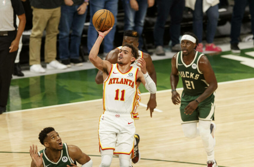 Atlanta Hawks guard Trae Young (11) shoots during the fourth quarter against the Milwaukee Bucks during game one of the Eastern Conference Finals for the 2021 NBA Playoffs at Fiserv Forum. Mandatory Credit: Jeff Hanisch-USA TODAY Sports