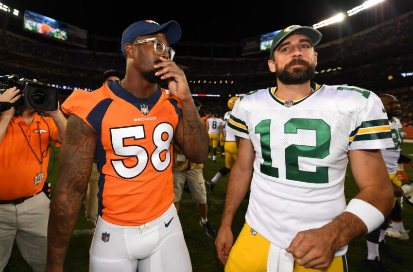 Packers QB Aaron Rodgers with Broncos OLB Von Miller. (Ron Chenoy-USA TODAY Sports)