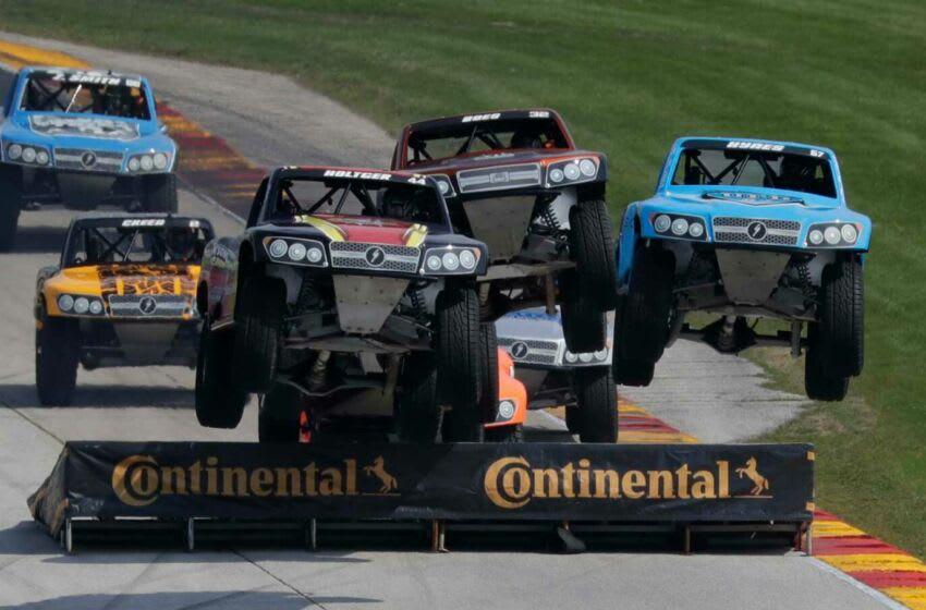 NASCAR Stadium Super Trucks leap into the air, Saturday, August 8, 2020, at Elkhart Lake, Wis. Road America.