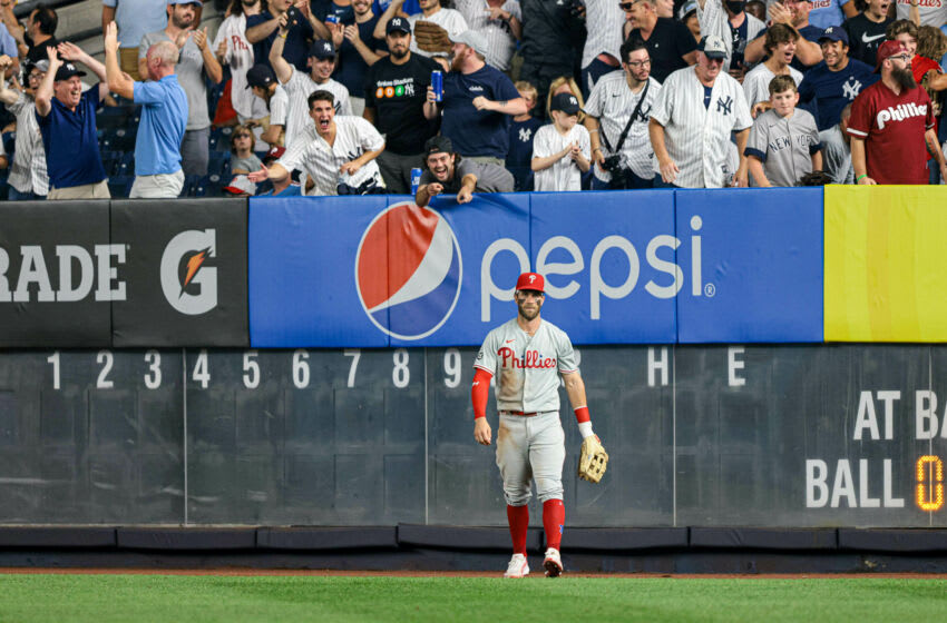 Jul 20, 2021; Bronx, New York, USA; Philadelphia Phillies right fielder Bryce Harper (3) reacts in front of fans after New York Yankees left fielder Brett Gardner (not pictured) hits a solo home run during the fifth inning at Yankee Stadium. Mandatory Credit: Vincent Carchietta-USA TODAY Sports