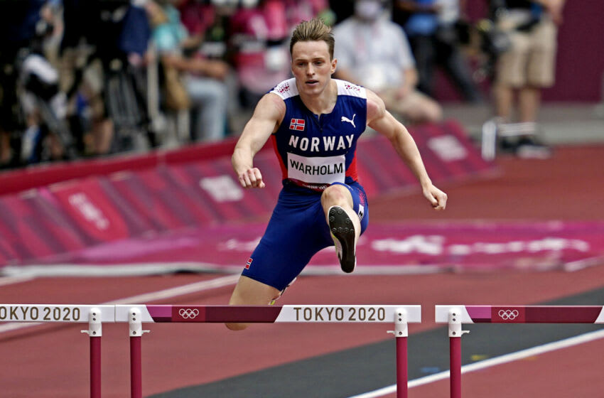 Jul 30, 2021; Tokyo, Japan; Karsten Warholm (NOR) competes in the men's 400m hurdles round 1 heat 3 during the Tokyo 2020 Olympic Summer Games at Olympic Stadium. Mandatory Credit: Andrew Nelles-USA TODAY Sports
