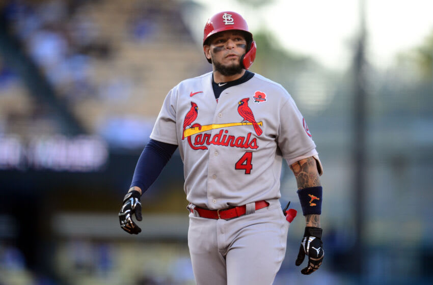 May 31, 2021; Los Angeles, California, USA; St. Louis Cardinals catcher Yadier Molina (4) reacts after Los Angeles Dodgers center fielder Cody Bellinger (35) catches a hit which results in him out during the second inning at Dodger Stadium. Mandatory Credit: Gary A. Vasquez-USA TODAY Sports