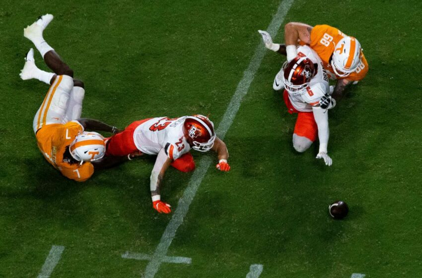 Bowling Green linebacker Darren Anders (23) and Bowling Green linebacker Bryce Brand (6) reach for a ball fumbled by Tennessee quarterback Joe Milton III (7) during a NCAA football game between the Tennessee Volunteers and the Bowling Green Falcons held at Neyland Stadium in Knoxville, Tenn., on Thursday, Sept. 2, 2021. Kns Ut Football Bowling Green Bp