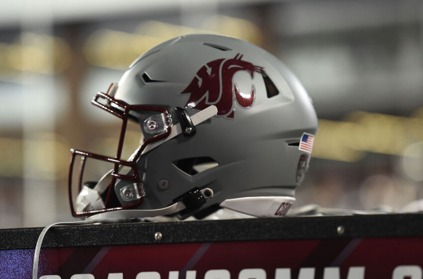 Sep 4, 2021; Pullman, Washington, USA; Washington State Cougars helmet sits during a game against the Utah State Aggies in the first half at Gesa Field at Martin Stadium. Mandatory Credit: James Snook-USA TODAY Sports