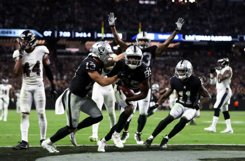 Sep 13, 2021; Paradise, Nevada, USA; Las Vegas Raiders wide receiver Bryan Edwards (89) celebrates after running the ball into the endzone against the Baltimore Ravens during overtime at Allegiant Stadium. The ruling would be Edwards stopped short at the goal line. Mandatory Credit: Mark J. Rebilas-USA TODAY Sports