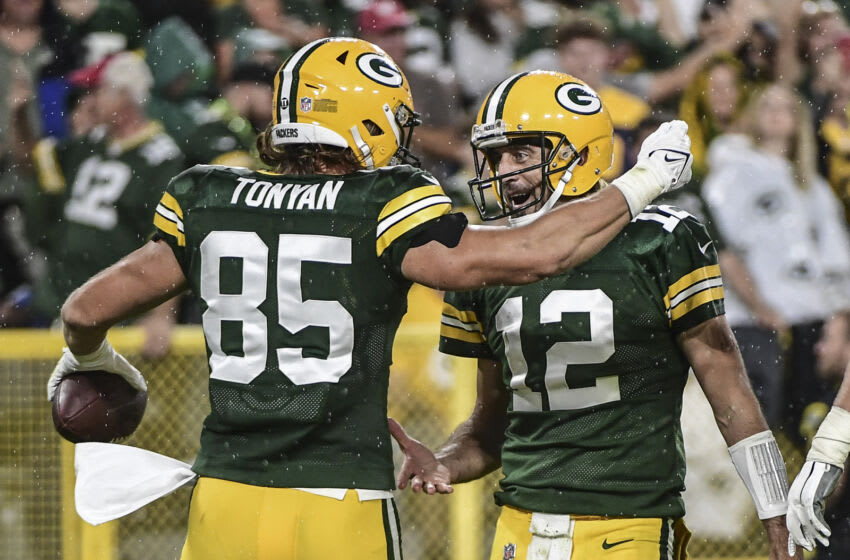 Sep 20, 2021; Green Bay, Wisconsin, USA; Green Bay Packers tight end Robert Tonyan (85) celebrates with quarterback Aaron Rodgers (12) after scoring a touchdown against the Detroit Lions in the third quarter at Lambeau Field. Mandatory Credit: Benny Sieu-USA TODAY Sports