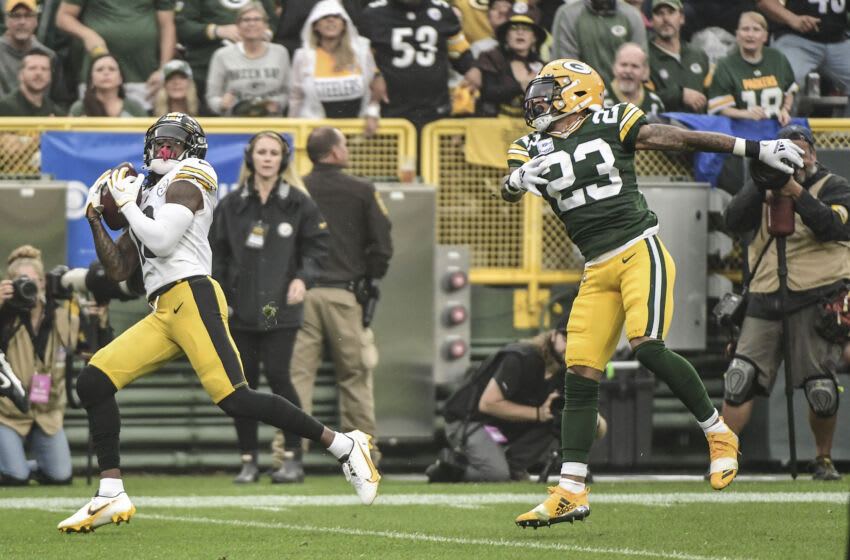 Oct 3, 2021; Green Bay, Wisconsin, USA; Pittsburgh Steelers wide receiver Diontae Johnson (18) catches a touchdown pass against Green Bay Packers cornerback Jaire Alexander (23) in the first quarter at Lambeau Field. Mandatory Credit: Benny Sieu-USA TODAY Sports