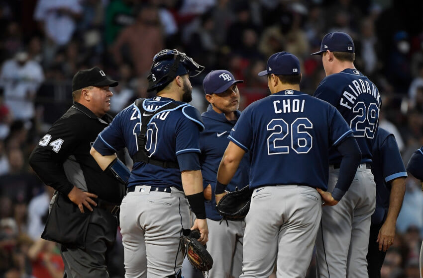 Oct 10, 2021; Boston, Massachusetts, USA; Tampa Bay Rays manager Kevin Cash (16) checks on relief pitcher Pete Fairbanks (29) during the fifth inning against the Boston Red Sox in game three of the 2021 ALDS at Fenway Park. Mandatory Credit: Bob DeChiara-USA TODAY Sports