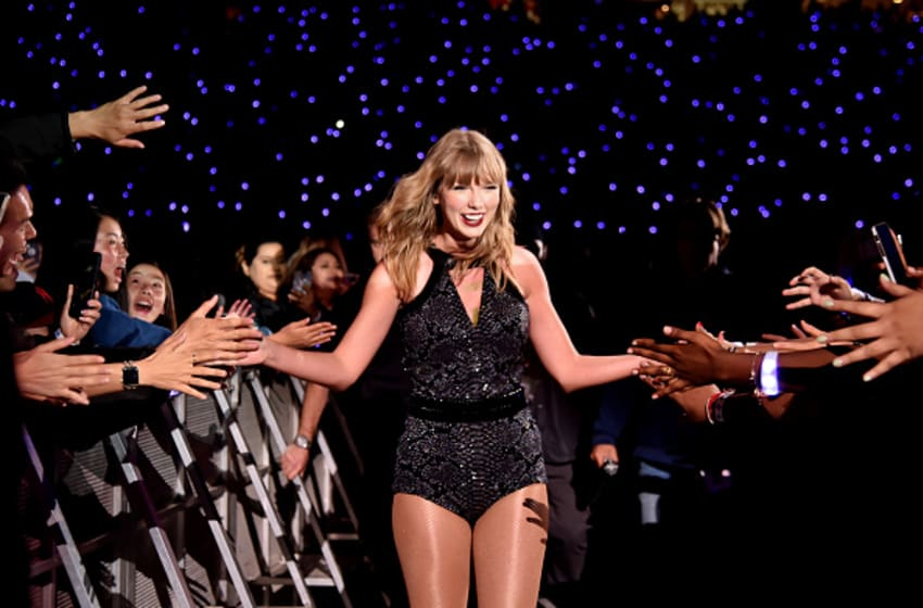 SANTA CLARA, CA - MAY 11: Taylor Swift high-fives fans during Taylor Swift reputation Stadium Tour at Levi's Stadium on May 11, 2018 in Santa Clara, California. (Photo by Kevin Mazur/TAS18/Getty Images)