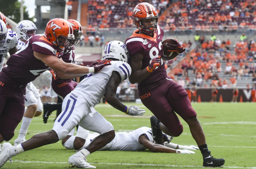 BLACKSBURG, VA - SEPTEMBER 14: Tight end James Mitchell #82 of the Virginia Tech Hokies scores a touchdown against the Furman Paladins in the second half at Lane Stadium on September 14, 2019 in Blacksburg, Virginia. (Photo by Michael Shroyer/Getty Images)