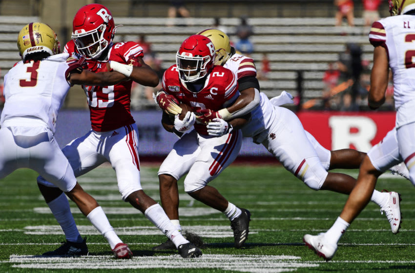 PISCATAWAY, NJ - SEPTEMBER 21: Raheem Blackshear #2 of the Rutgers Scarlet Knights is tackled by John Lamot #28 of the Boston College Eagles as Isaiah Washington #83 of the Rutgers Scarlet Knights defends against Jason Maitre #3 of the Boston College Eagles during the fourth quarter at SHI Stadium on September 21, 2019 in Piscataway, New Jersey. Boston College defeated Rutgers 30-16. (Photo by Corey Perrine/Getty Images)