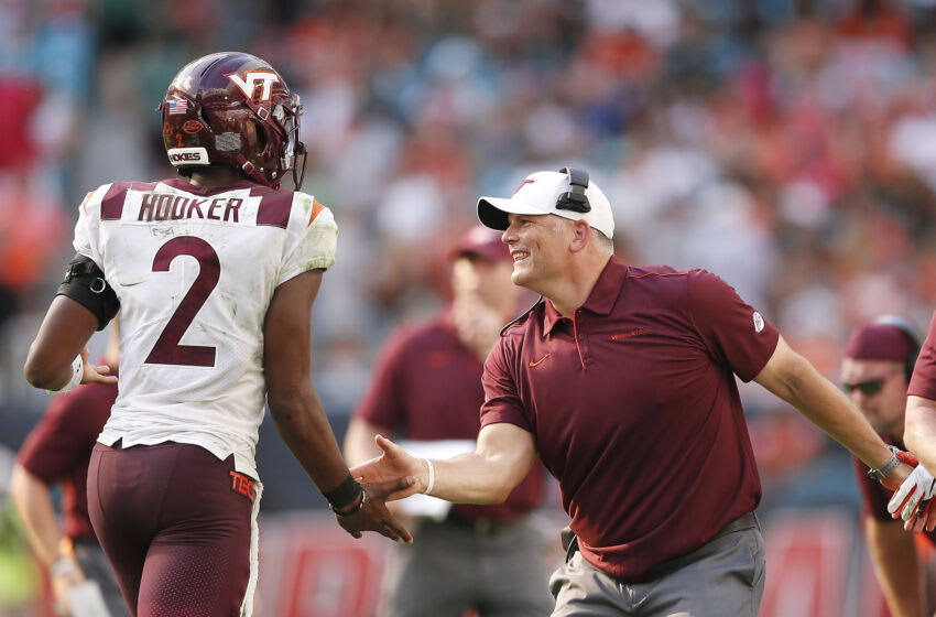 MIAMI, FLORIDA - OCTOBER 05: Head coach Justin Fuente of the Virginia Tech Hokies celebrates after a touchdown with Hendon Hooker #2 against the Miami Hurricanes during the first half at Hard Rock Stadium on October 05, 2019 in Miami, Florida. (Photo by Michael Reaves/Getty Images)