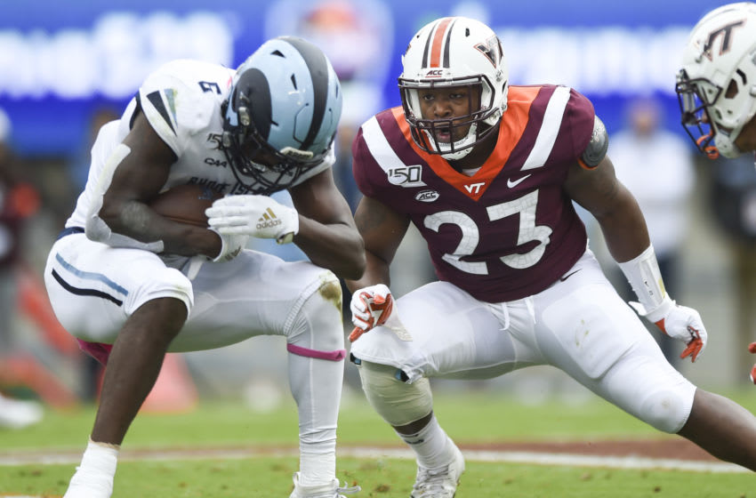 BLACKSBURG, VA - OCTOBER 12: Linebacker Rayshard Ashby #23 of the Virginia Tech Hokies looks to make a tackle against the Rhode Island Rams in the first half at Lane Stadium on October 12, 2019 in Blacksburg, Virginia. (Photo by Michael Shroyer/Getty Images)