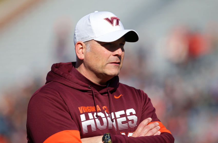 CHARLOTTESVILLE, VA - NOVEMBER 29: Head coach Justin Fuente of the Virginia Tech Hokies watches his team warm up before the start of a game against the Virginia Cavaliers at Scott Stadium on November 29, 2019 in Charlottesville, Virginia. (Photo by Ryan M. Kelly/Getty Images)