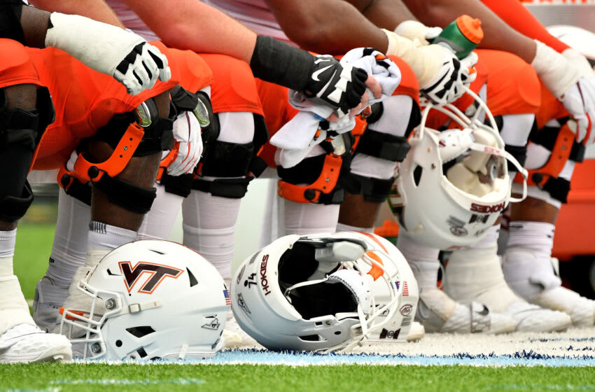 CHAPEL HILL, NORTH CAROLINA - OCTOBER 10: The Virginia Tech Hokies offensive line waits to go back into the game against the North Carolina Tar Heels at Kenan Stadium on October 10, 2020 in Chapel Hill, North Carolina. North Carolina won 56-45. (Photo by Grant Halverson/Getty Images)