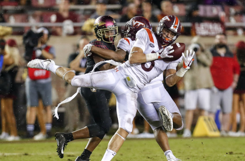 TALLAHASSEE, FL - SEPTEMBER 3: Cornerback Caleb Farley #3 of the Virginia Tech Hokies intercepts the ball over Wide Receiver Nyqwan Murray #8 of the Florida State Seminoles during the game at Doak Campbell Stadium on Bobby Bowden Field on September 3, 2018 in Tallahassee, Florida. The #20 ranked Hokies defeated the #19 ranked Seminoles 24 to 3. (Photo by Don Juan Moore/Getty Images)