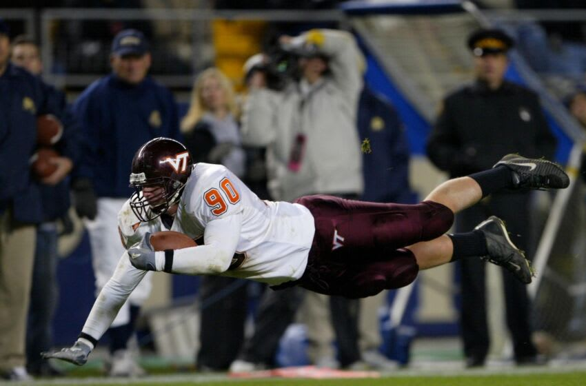 PITTSBURGH - NOVEMBER 8: Jeff King #90 of the Virginia Tech Hokies dives for a first down against the University of Pittsburgh Panthers during NCAA football action on November 8, 2003 at Heinz Field in Pittsburgh, Pennsylvania. (Photo by Doug Pensinger/Getty Images)