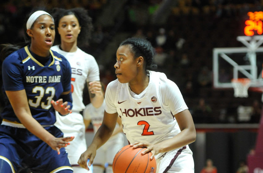 Jan 16, 2019; Blacksburg, VA, USA; Virginia Tech Hokies guard Aisha Sheppard (2) drives to the basket while being defended by Notre Dame Fighting Irish forward Danielle Patterson (33) in the second half at Cassell Coliseum. Mandatory Credit: Michael Shroyer-USA TODAY Sports
