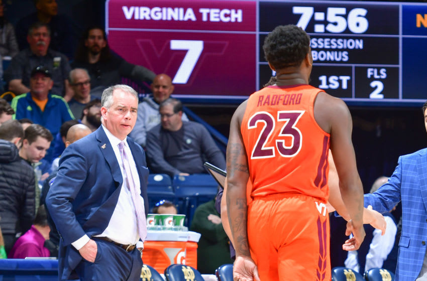Mar 7, 2020; South Bend, Indiana, USA; Virginia Tech Hokies head coach Mike Young talks to guard Tyrece Radford (23) during a timeout in the first half against the Notre Dame Fighting Irish at the Purcell Pavilion. Mandatory Credit: Matt Cashore-USA TODAY Sports