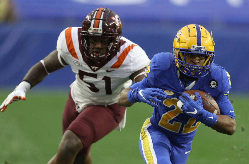 Nov 21, 2020; Pittsburgh, Pennsylvania, USA; Pittsburgh Panthers running back Vincent Davis (22) runs after a catch as Virginia Tech Hokies defensive lineman Robert Wooten (51) chases during the first quarter at Heinz Field. Mandatory Credit: Charles LeClaire-USA TODAY Sports