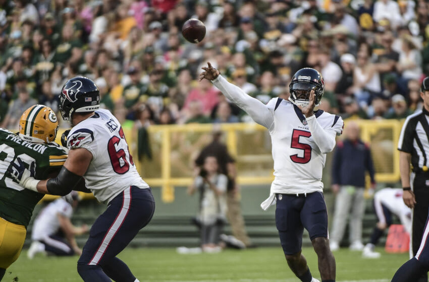 Aug 14, 2021; Green Bay, Wisconsin, USA; Houston Texans quarterback Tyrod Taylor (5) throws a pass against the Green Bay Packers in the first quarter during the game at Lambeau Field. Mandatory Credit: Benny Sieu-USA TODAY Sports