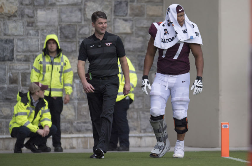 Sep 8, 2018; Blacksburg, VA, USA; Virginia Tech Hokies offensive lineman Christian Darrisaw(77) walks off the field in a support boot during the second half against the William & Mary Tribe at Lane Stadium. Mandatory Credit: Lee Luther Jr.-USA TODAY Sports
