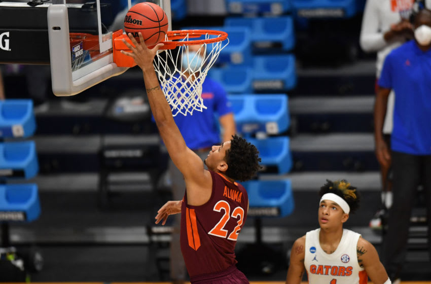 Mar 19, 2021; Indianapolis, Indiana, USA; Virginia Tech Hokies forward Keve Aluma (22) shoots against Florida Gators guard Tre Mann (1) during the first round of the 2021 NCAA Tournament at Hinkle Fieldhouse. Mandatory Credit: Patrick Gorski-USA TODAY Sports