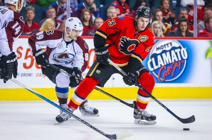 Mar 18, 2016; Calgary, Alberta, CAN; Calgary Flames center Sean Monahan (23) controls the puck against the Colorado Avalanche during the overtime period at Scotiabank Saddledome. Colorado Avalanche won 4-3. Mandatory Credit: Sergei Belski-USA TODAY Sports