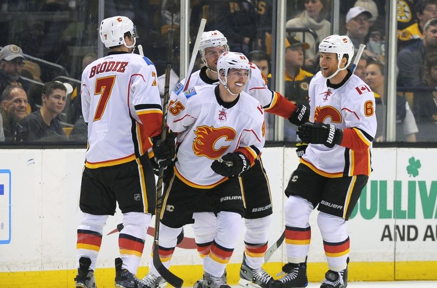 Nov 25, 2016; Boston, MA, USA; Calgary Flames center Sam Bennett (93) is congratulated by his teammates after scoring a goal during the first period against the Boston Bruins at TD Garden. Mandatory Credit: Bob DeChiara-USA TODAY Sports