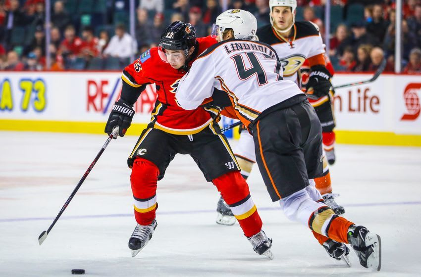 Dec 4, 2016; Calgary, Alberta, CAN; Calgary Flames left wing Johnny Gaudreau (13) and Anaheim Ducks defenseman Hampus Lindholm (47) battle for the puck during the third period at Scotiabank Saddledome. Calgary Flames won 8-3. Mandatory Credit: Sergei Belski-USA TODAY Sports