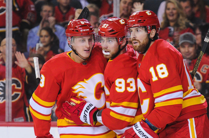 CALGARY, AB - OCTOBER 17: Juuso Valimaki #8 (L) of the Calgary Flames celebrates with Sam Bennett #93 and James Neal #18 after scoring against the Boston Bruins during an NHL game at Scotiabank Saddledome on October 17, 2018 in Calgary, Alberta, Canada. (Photo by Derek Leung/Getty Images)