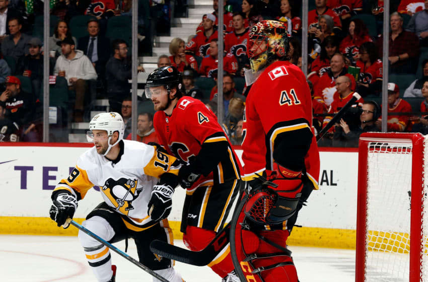 CALGARY, AB - OCTOBER 25: Pittsburgh Penguins Left Wing Derick Brassard #19 and Calgary Flames Defenceman Rasmus Andersson #4 look on near the crease of Calgary Flames Goalie Mike Smith #41 during an NHL game on October 25, 2018 at the Scotiabank Saddledome in Calgary, Alberta, Canada. (Photo by Gerry Thomas/NHLI via Getty Images)