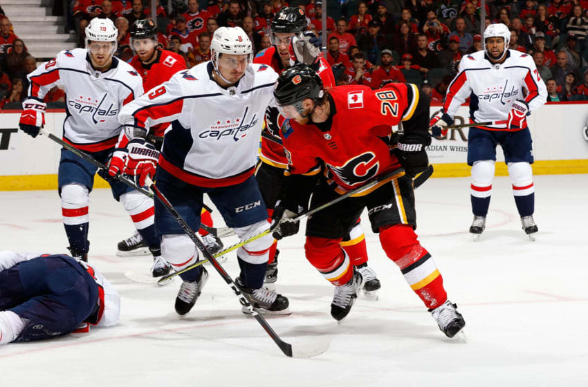 CALGARY, AB - OCTOBER 27: Elias Lindholm #28 of the Calgary Flames skates against Dmitry Orlov #9 of the Washington Capitals during an NHL game on October 27, 2018 at the Scotiabank Saddledome in Calgary, Alberta, Canada. (Photo by Gerry Thomas/NHLI via Getty Images)