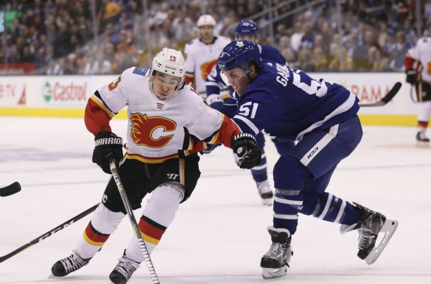 TORONTO, ON - October 29 In second period action, Calgary Flames left wing Johnny Gaudreau (13) makes a move around Toronto Maple Leafs defenseman Jake Gardiner (51) The Toronto Maple Leafs took on the Calgary Flames at the Scotiabank Arena in Toronto. October 29, 2018 (Richard Lautens/Toronto Star via Getty Images)