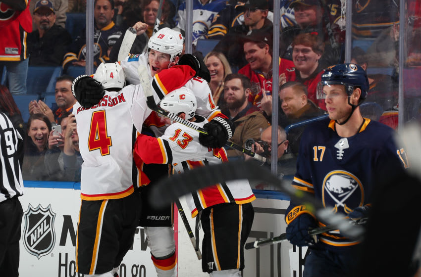 BUFFALO, NY - OCTOBER 30: Matthew Tkachuk #19 of the Calgary Flames celebrates his third period goal against the Buffalo Sabres during an NHL game on October 30, 2018 at KeyBank Center in Buffalo, New York. Calgary won, 2-1, in overtime. (Photo by Bill Wippert/NHLI via Getty Images)