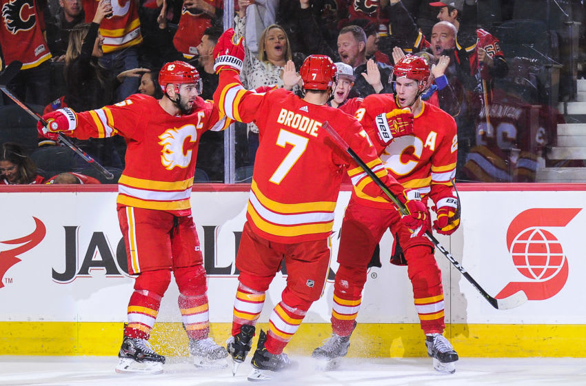 CALGARY, AB - NOVEMBER 3: Sean Monahan #23 (R) of the Calgary Flames celebrates with his teammates after scoring against the Chicago Blackhawks to tie the game 3-3 during an NHL game at Scotiabank Saddledome on November 3, 2018 in Calgary, Alberta, Canada. (Photo by Derek Leung/Getty Images)