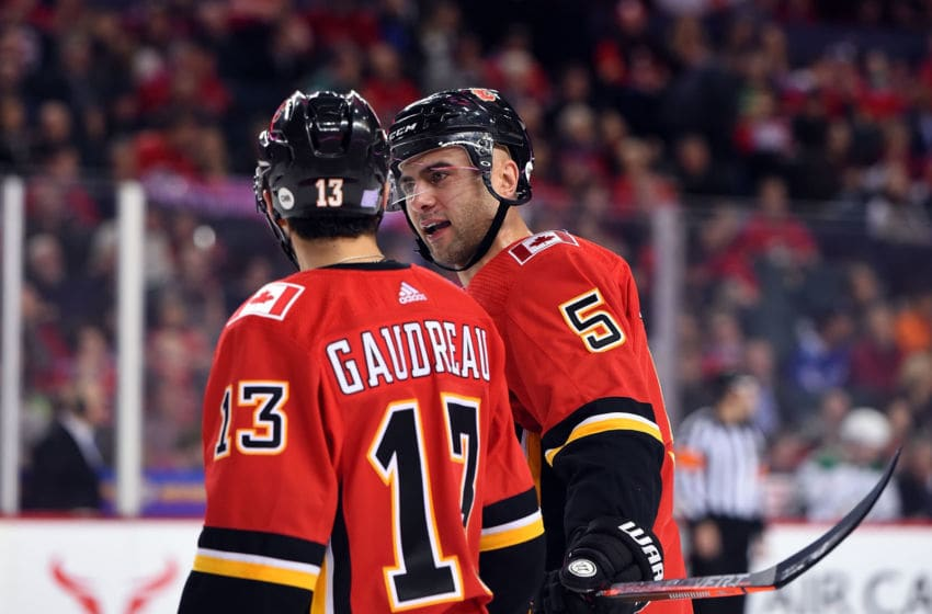 CALGARY, AB - NOVEMBER 28: Calgary Flames Left Wing Johnny Gaudreau (13) and Defenceman Mark Giordano (5) discuss strategy between whistles during the first period of an NHL game where the Calgary Flames hosted the Dallas Stars on November 28, 2018, at the Scotiabank Saddledome in Calgary, AB. (Photo by Brett Holmes/Icon Sportswire via Getty Images)