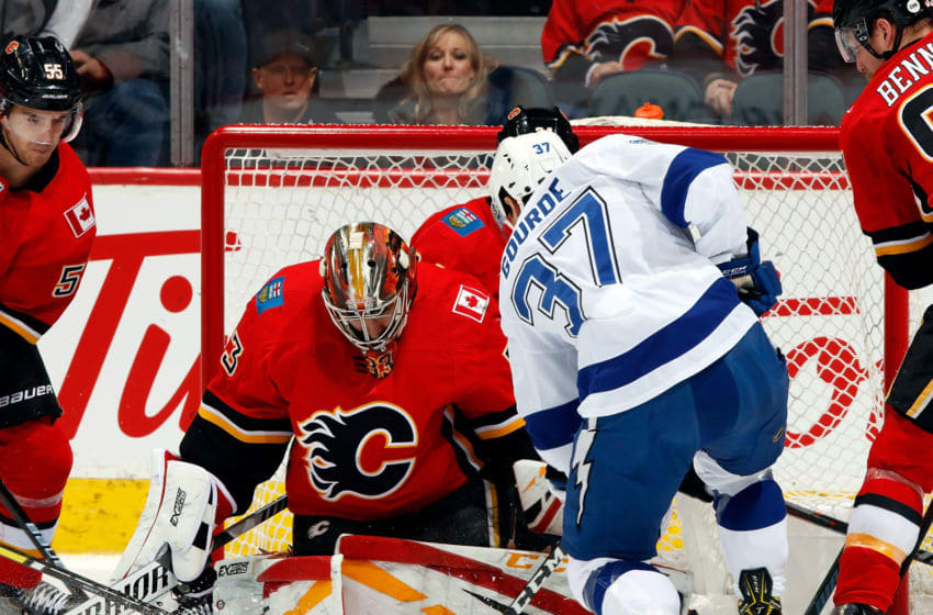 CALGARY, AB - DECEMBER 20: Yanni Gourde #37 of the Tampa Bay Lightning looks for a rebound off David Rittich #33 of the Calgary Flames during an NHL game on December 20, 2018 at the Scotiabank Saddledome in Calgary, Alberta, Canada. (Photo by Gerry Thomas/NHLI via Getty Images)