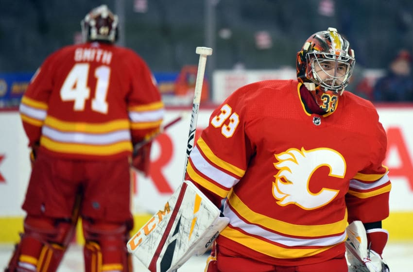 CALGARY, AB - DECEMBER 22: Calgary Flames Goalie David Rittich (33) and Goalie Mike Smith (41) warm up before an NHL game where the Calgary Flames hosted the St. Louis Blues on December 22, 2018, at the Scotiabank Saddledome in Calgary, AB. (Photo by Brett Holmes/Icon Sportswire via Getty Images)
