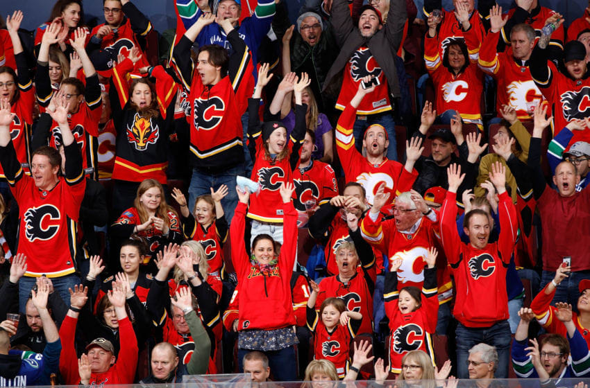 CALGARY, AB - DECEMBER 29: Fans cheer during an NHL game between the Calgary Flames and Vancouver Canucks on December 29, 2018 at the Scotiabank Saddledome in Calgary, Alberta, Canada. (Photo by Gerry Thomas/NHLI via Getty Images)