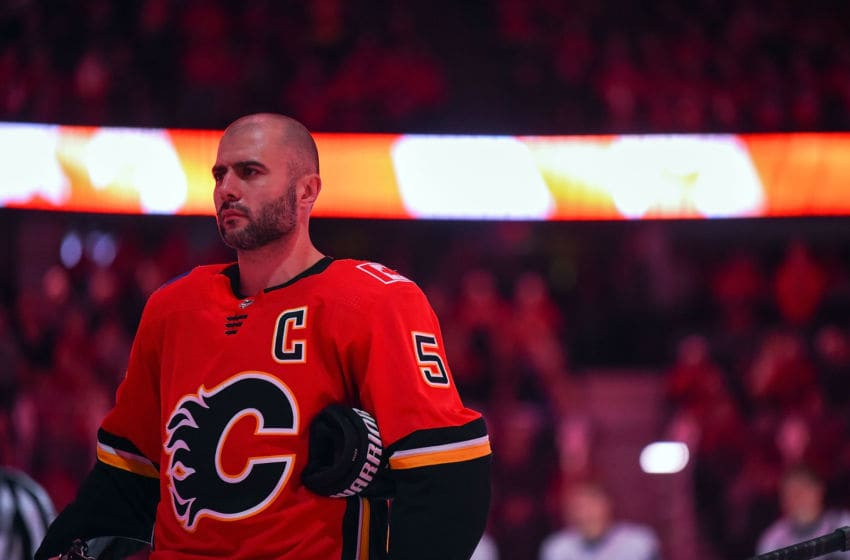 CALGARY, AB - DECEMBER 31: Mark Giordano #5 of the Calgary Flames stands for the national anthems before an NHL game against the San Jose Sharks on December 31, 2018 at the Scotiabank Saddledome in Calgary, Alberta, Canada. (Photo by Brett Holmes/NHLI via Getty Images)