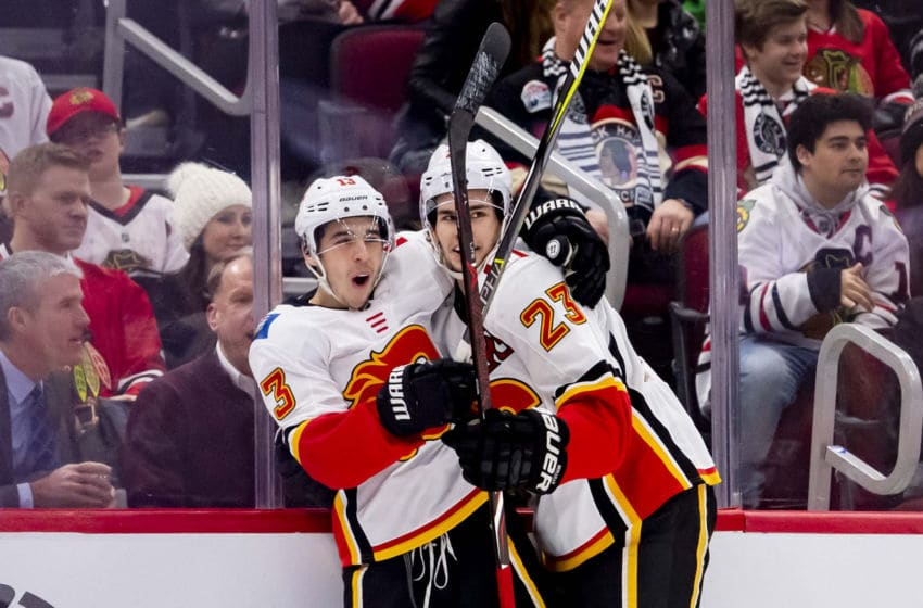 CHICAGO, IL - JANUARY 07: Calgary Flames left wing Johnny Gaudreau (13) celebrates his goal with Calgary Flames center Sean Monahan (23) during a game between the Calgary Flames and the Chicago Blackhawks on January 7, 2019, at the United Center in Chicago, IL. (Photo by Patrick Gorski/Icon Sportswire via Getty Images)